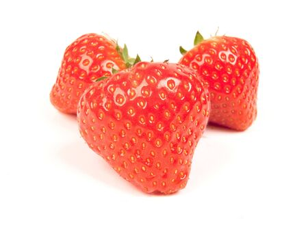 close up with three strawberrys on white background