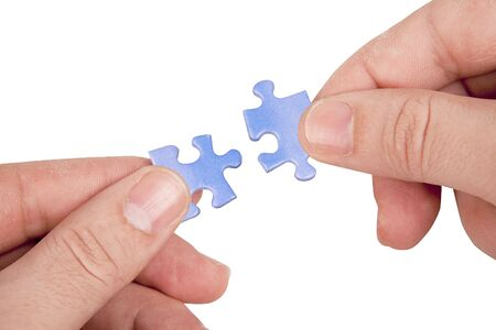hands joining puzzle pieces photo