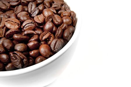detail of a cup filled with coffee beans