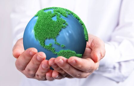 holding a green earth