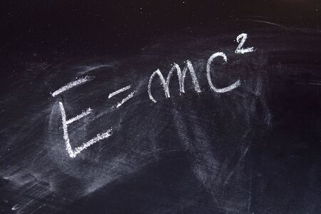 energy formula on chalkboard