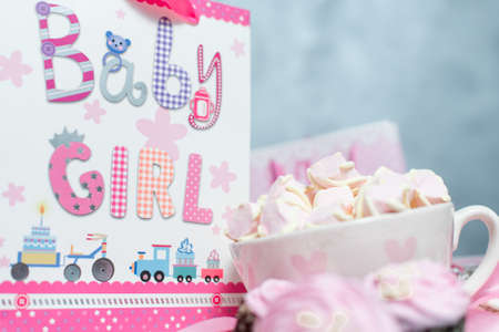 marshmellow: Maternity pregnancy background. Pink marshmellow and gift pack Stock Photo