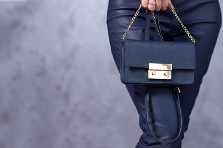 Bags fashion trends. Close up of gorgeous stylish bag. Fashionable woman is holding a trendy bag. Stylish trendy accessories concept