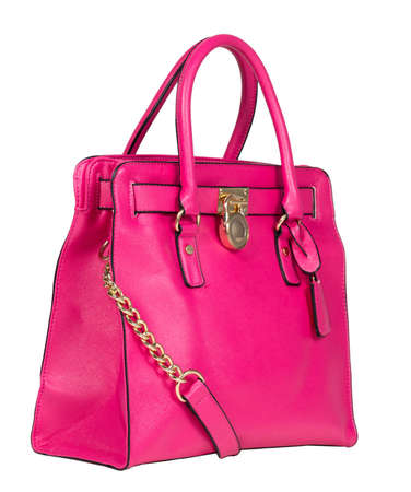 Pink stylish female leather bag isolated on white background. Fashionable and high style expensive female bag