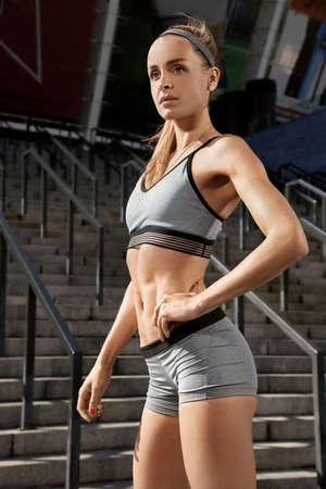 Perfect outdoor female fitness training. Portrait of young and beautiful girl is having sport outdoor workout. Active gym workout. Healthy sportsmen concept
