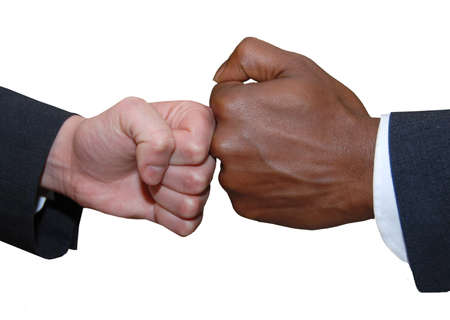 greet: African and European business people fist pushing against each other, fist greet
