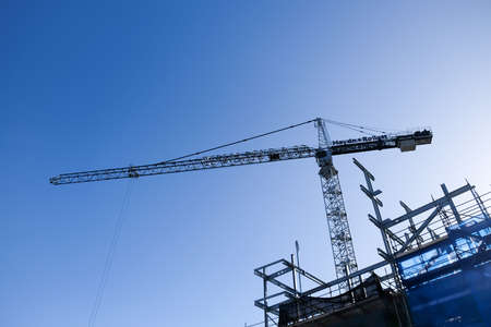 Auckland, New Zealand, NZ - June 15, 2017: Construction crane at a building site in Viaduct Harbour