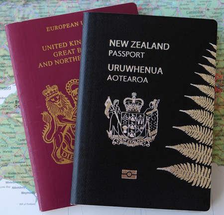 Two new zealand nz passports on a map of europe stock photo two passports united kingdom uk and new zealand nz on a map of england ccuart Choice Image