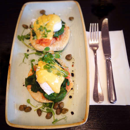 florentine: Eggs benedict or eggs florentine with salmon, spinach & capers at a cafe in New Zealand, NZ