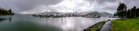 Panorama of Whangaroa Harbour boat marina on a rainy overcast day in Northland, New Zealand, NZ Stock Photo