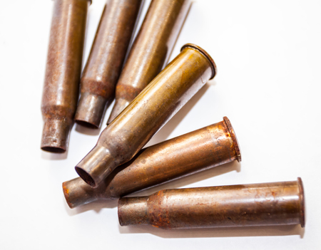 Empty bullet shells on a white background