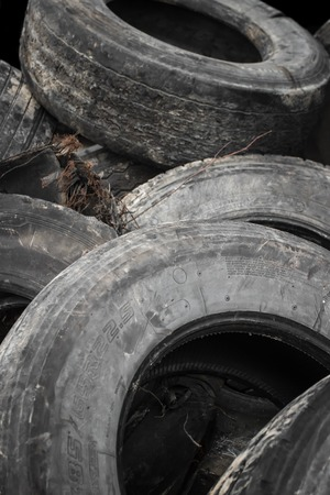 Old used tires stacked in a big pile