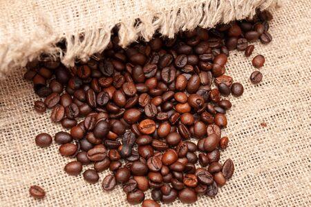 Coffee beans on old burlap background Zdjęcie Seryjne