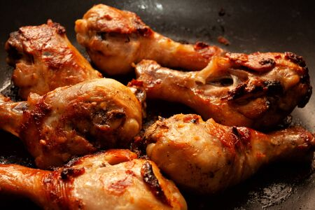 Roasted chicken legs in a pan