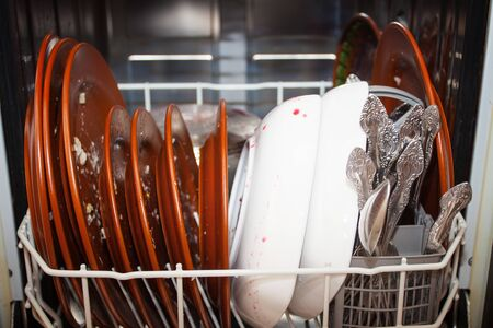 Dirty dishes in an open dishwasher