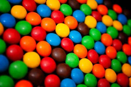Colorful chocolate dragees for background