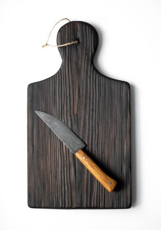 Kitchen wooden board with knife on white background
