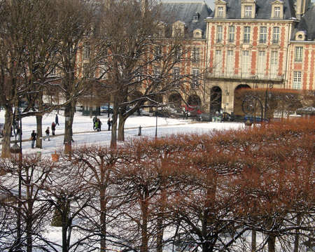 parliamentarian: Paris France the Place Des Vosges Square with a covering of WInter Snow Stock Photo