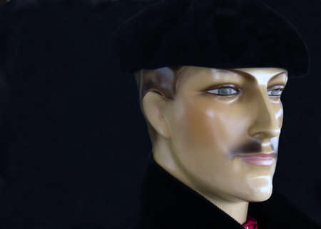 sitter: Man in black beret Stock Photo