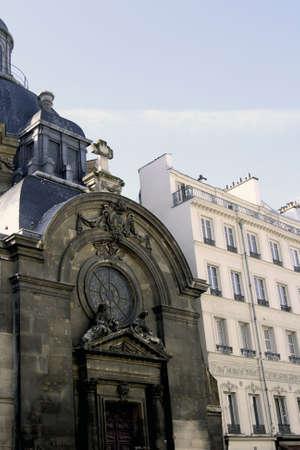 condos: paris architecture and the church in the shadows near the Marais area Stock Photo