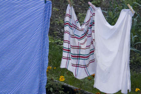 Hanging the towels out to dry a a fall crisp day Фото со стока