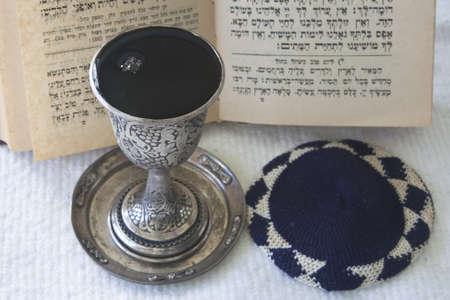 Judaism -  Kiddush, prayer book, skullcap photo