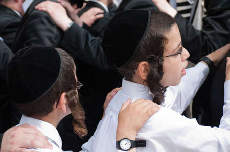 Jewish religious children dancing in Jerusalem in October for Succot holiday