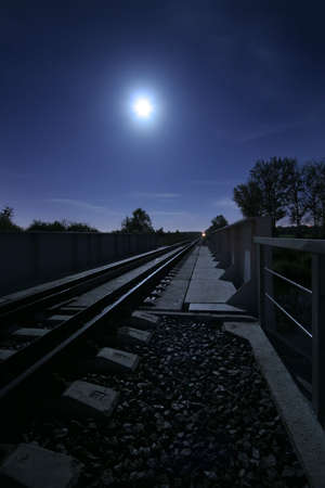 long railway in the light of the full moon