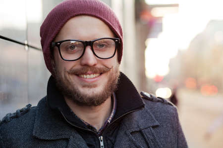 Young smiling hipster with moustache, beard and glasses Reklamní fotografie
