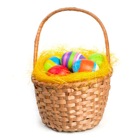 Coloured easter eggs in a braided basket