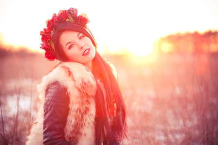 Girl wearing flur vest in winter field lifestyle photo