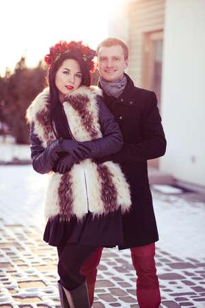 Stylish couple having a walk in the city in winter Reklamní fotografie