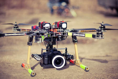 Preparing to take aero photo using octocopter flying drone Reklamní fotografie