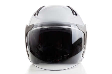 Glossy white motorcycle helmet isolated on background