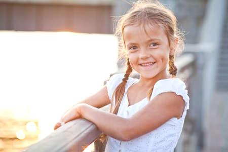 Happy young girl in a city Reklamní fotografie - 31020382