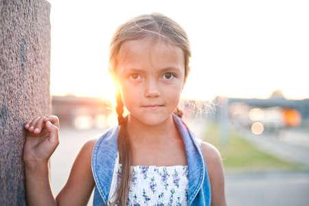 Happy young girl in a city Reklamní fotografie - 31020401