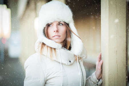 Winter girl in warm clothes snowy day Reklamní fotografie - 35237097