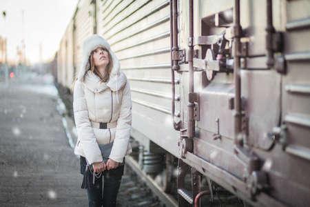 Stylish woman in snowy day on a platform Reklamní fotografie - 35237136