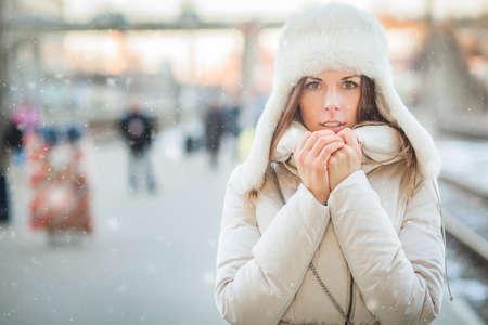 Youn woman on a train station in winter Reklamní fotografie