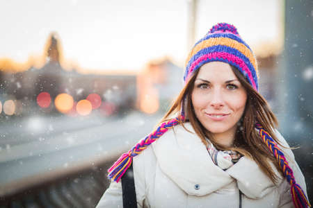 Positive girl with colorfull hat in winter city Reklamní fotografie - 35237144