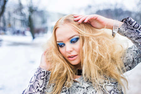 Blonde lady is posing in the winter Reklamní fotografie - 35856501