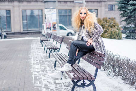 Woman on a bench in the city