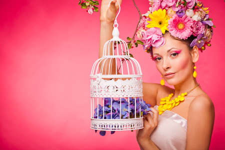 girl with a birdcage and flowers Reklamní fotografie - 36164520