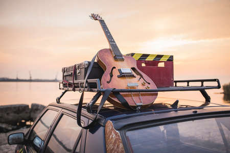 Music instrumental guitar car outdoor background Standard-Bild