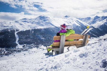 Young couple hugging ski resort winter mountains Reklamní fotografie - 37371030