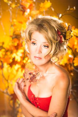 Magic gold autumn blonde girl portrait in leafs Reklamní fotografie - 37369374