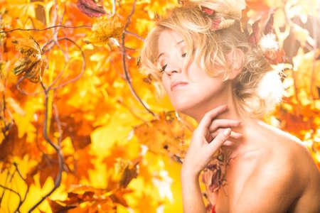 Magic gold autumn blonde girl portrait in leafs Reklamní fotografie - 37369382