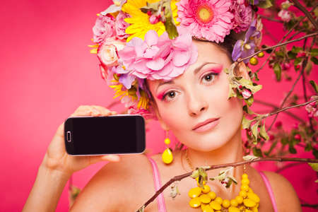 Girl under spring flowers with smartphone mockup