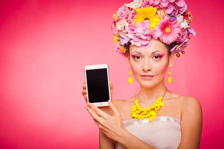 Smartphone app demonstration by woman in flowers Reklamní fotografie - 38012719