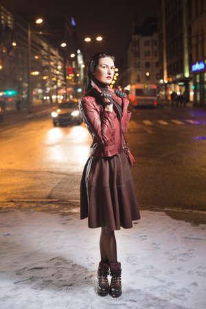 Fashion model look outside on a city street Reklamní fotografie - 38746142